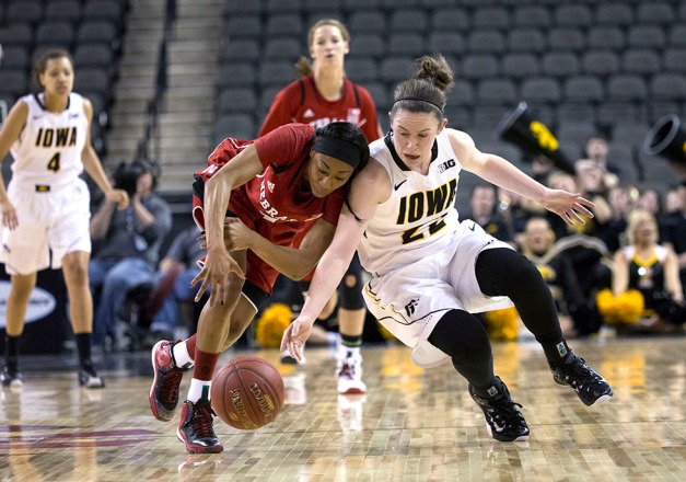 Iowa Hawkeyes guard Samantha Logic (22) battles for a loose ball with Nebraska Cornhuskers guard Tear'a Laudermill (1) during the first half or their game in the quarter finals of the 2015 BIG Ten Tournament Friday, March 6, 2015 at the Sears Centre Arena in Hoffman Estates, Ill.  (Brian Ray/hawkeyesports.com)