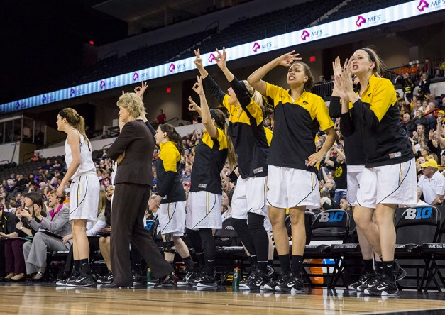 The Iowa Hawkeyes bench reacts to a three point basket during the second half of their semi-final game against the Ohio State Buckeyes Saturday, March 7, 2015 at the Sears Centre in Hoffman Estates, Ill.  (Brian Ray/hawkeyesports.com)