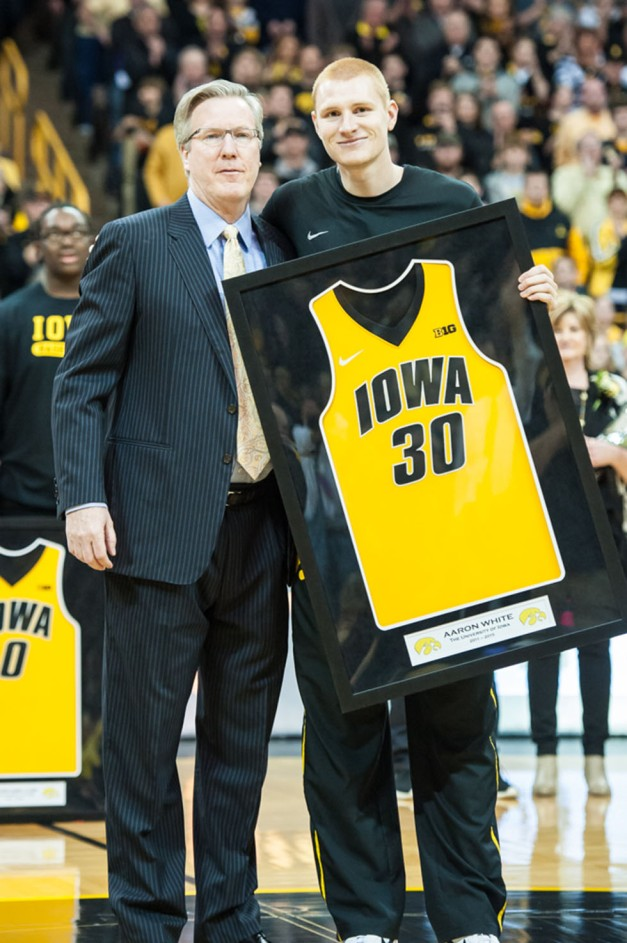 Iowa Hawkeyes forward Aaron White (30) stands with head coach Fran McCaffery  during senior day activities Saturday, Mar 7, 2015 at Carver-Hawkeye Arena. Mandatory Credit: Jeffrey Becker-USA TODAY Sports