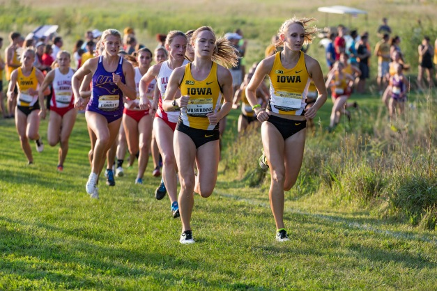 Iowa's Madison Waymire and Tess Wilberding lead the pack during the Hawkeye Early Bird Invitational Friday, Sept. 4, 2015 at the Ashton Cross Country Course.  (Brian Ray/hawkeyesports.com)