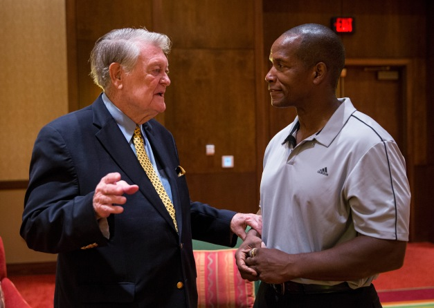 Former Hawkeye Football head coach Hayden Fry talks with former linebacker Larry Station during FryFest Friday, Sept. 4, 2015 at the Coralville Marriott Hotel and Convention Center.  (Brian Ray/hawkeyesports.com)