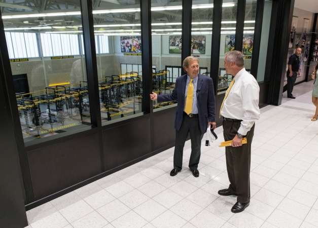 New University of Iowa President Bruce Harreld looks around the Hansen Football Performance Center with UI Director of Athletics Gary Barta after addressing  the Hawkeye Football Team Friday, Sept. 4, 2015. Harreld was named the UI's 21st president by the Board of Regents State of Iowa on Thursday.  (Brian Ray/hawkeyesports.com)