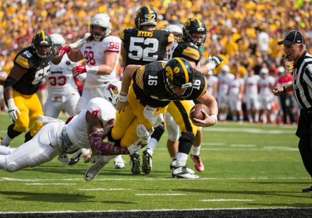Iowa Hawkeyes quarterback C.J. Beathard (16) fights his way into the end zone during the first half of their game against the Illinois State Redbirds Saturday, Sept. 5, 2015 at Kinnick Stadium.  (Brian Ray/hawkeyesports.com)