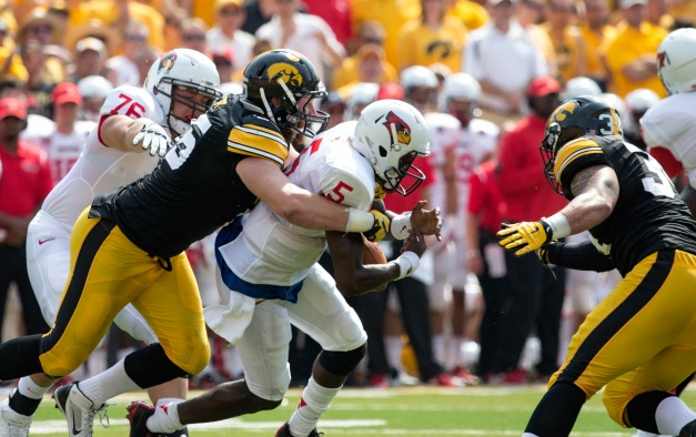 Iowa Hawkeyes defensive lineman Drew Ott (95) strips the ball from Illinois State Redbirds quarterback Tre Roberson (5) during the first half of their game Saturday, Sept. 5, 2015 at Kinnick Stadium.  (Brian Ray/hawkeyesports.com)