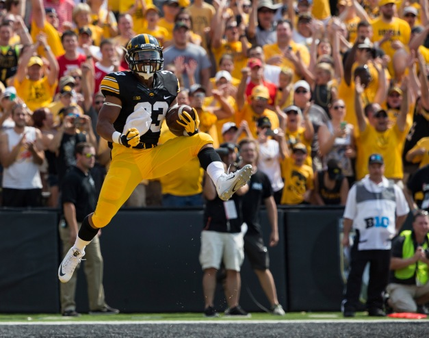 Iowa Hawkeyes running back Jordan Canzeri (33) celebrates after scoring during the first half of their game against the Illinois State Redbirds Saturday, Sept. 5, 2015 at Kinnick Stadium.  (Brian Ray/hawkeyesports.com)