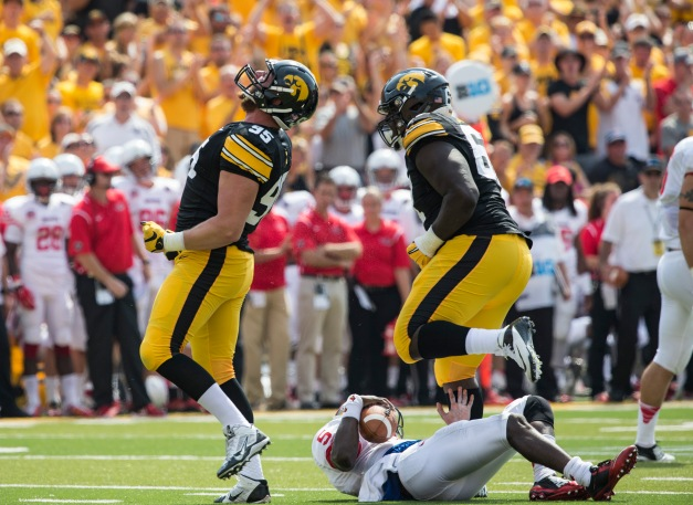 Iowa Hawkeyes defensive lineman Drew Ott (95) celebrates after sacking Illinois State Redbirds quarterback Tre Roberson (5) during the first half of their game Saturday, Sept. 5, 2015 at Kinnick Stadium.  (Brian Ray/hawkeyesports.com)