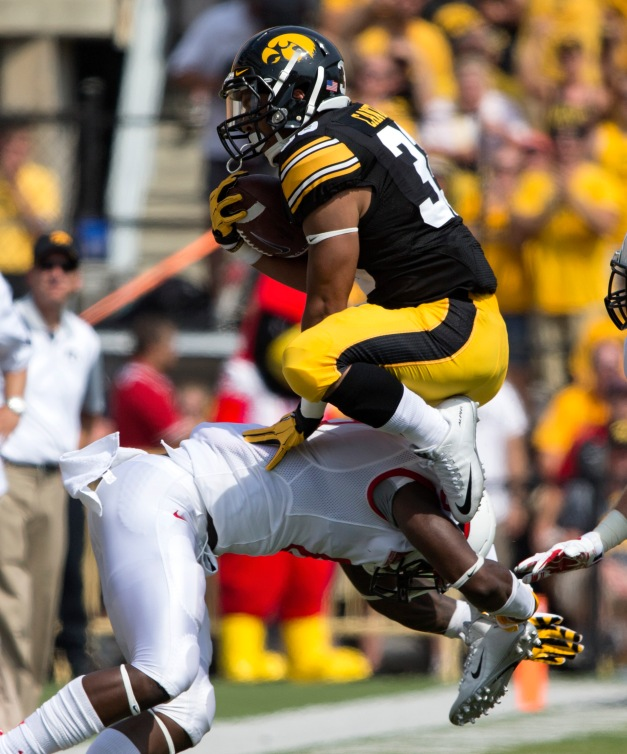 Iowa Hawkeyes running back Jordan Canzeri (33) tries to leap over an Illinois State Redbirds defender during the first half of their game Saturday, Sept. 5, 2015 at Kinnick Stadium.  (Brian Ray/hawkeyesports.com)