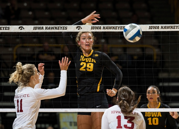 Iowa Hawkeyes middle blocker Jess Janota (29) tips the ball over the net during their game against the Iowa State Cyclones in the Iowa Corn Cy-Hawk Series Friday, Sept. 11, 2015 at the Carver-Hawkeye Arena. (Brian Ray/hawkeyesports.com)