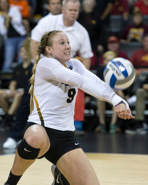 Iowa Hawkeyes defensive specialist Annika Olsen (9) bumps the ball during their game against the Iowa State Cyclones in the Iowa Corn Cy-Hawk Series Friday, Sept. 11, 2015 at the Carver-Hawkeye Arena. (Brian Ray/hawkeyesports.com)