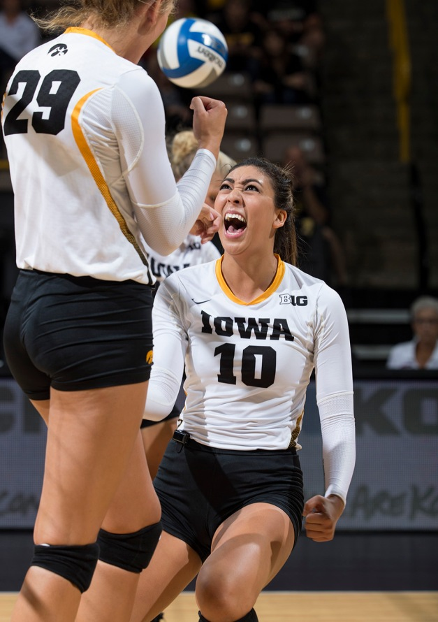 Iowa Hawkeyes setter Loxley Keala (10) and middle blocker Jess Janota (29) celebrate a point during their game against Milwaukee Friday, Sept. 11, 2015 at Carver-Hawkeye Arena. (Brian Ray/hawkeyesports.com)