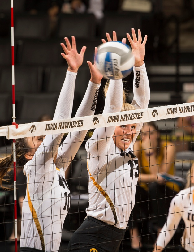 Iowa Hawkeyes setter Loxley Keala (10) and middle blocker Mikaela Gunderson (13) go up for a block during their game against Milwaukee Friday, Sept. 11, 2015 at Carver-Hawkeye Arena. (Brian Ray/hawkeyesports.com)