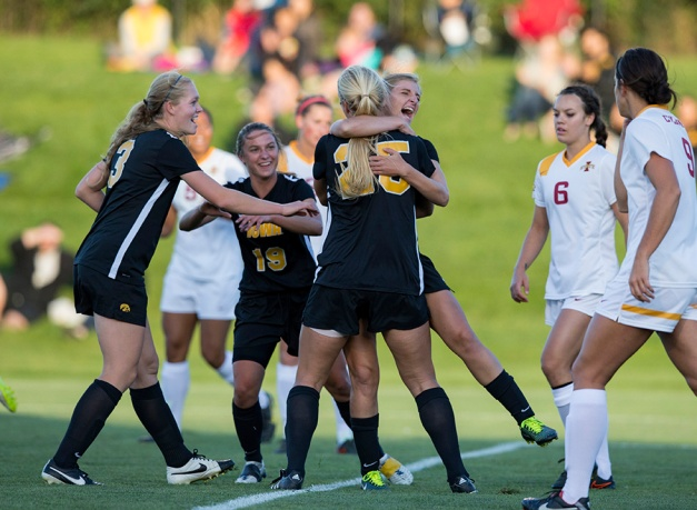 Iowa Hawkeyes Tory Harman (25) hugs Jenna Kentgen (8) after heading in a corner kick during their game in the Iowa Corn Cy-Hawk Series Friday, Sept. 11, 2015 at the Iowa Soccer Complex. The Hawkeyes won the game 1-0. (Brian Ray/hawkeyesports.com)