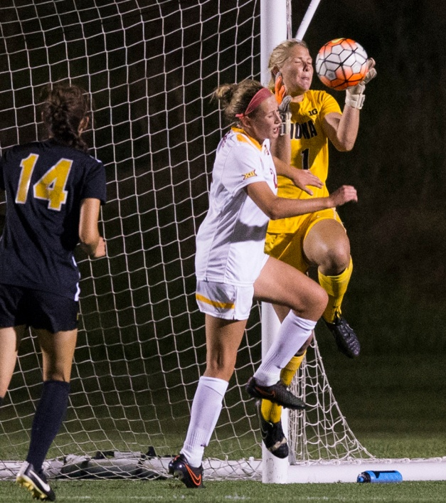 Iowa Hawkeyes Hannah Clark (1) saves a ball in front of Iowa State Cyclones Koree Willer (2) during their game in the Iowa Corn Cy-Hawk Series Friday, Sept. 11, 2015 at the Iowa Soccer Complex. (Brian Ray/hawkeyesports.com)