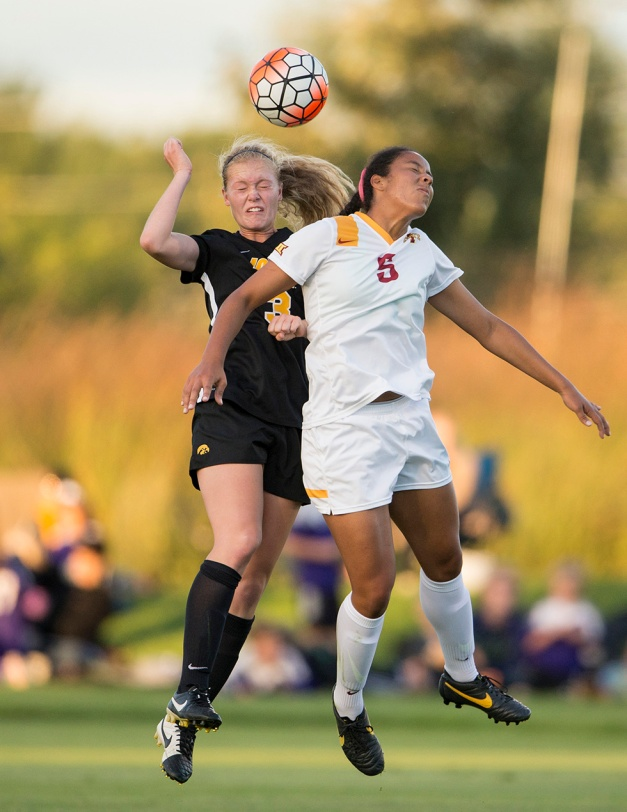 Iowa Hawkeyes Morgan Kemmerling (3) goes up to head the ball against Iowa State Cyclones Brianna Johnson (5) during their game in the Iowa Corn Cy-Hawk Series Friday, Sept. 11, 2015 at the Iowa Soccer Complex. (Brian Ray/hawkeyesports.com)