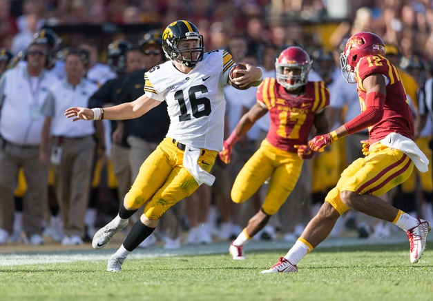 Iowa Hawkeyes quarterback C.J. Beathard (16) carries the a ball on a long run during the first half of their game against the Iowa State Cyclones in the Iowa Corn Cy-Hawk Series Saturday, Sept. 12, 2015 at the Jack Trice Stadium in Ames. (Brian Ray/hawkeyesports.com)