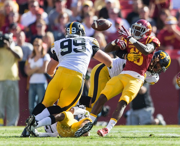Iowa Hawkeyes defensive end Nate Meier (34) causes Iowa State Cyclones wide receiver Dondre Daley (13) to fumble the ball during the first half of their game in the Iowa Corn Cy-Hawk Series Saturday, Sept. 12, 2015 at the Jack Trice Stadium in Ames. (Brian Ray/hawkeyesports.com)