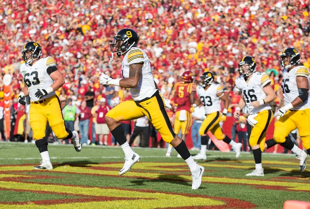 Iowa Hawkeyes wide receiver Tevaun Smith (4) celebrates after pulling down a touchdown pass during the first half of their game against the Iowa State Cyclones in the Iowa Corn Cy-Hawk Series Saturday, Sept. 12, 2015 at the Jack Trice Stadium in Ames. (Brian Ray/hawkeyesports.com)