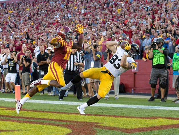Iowa Hawkeyes wide receiver Riley McCarron (83) pulls down a touchdown pass over Iowa State Cyclones defensive back Jomal Wiltz (17) during the second half of their game in the Iowa Corn Cy-Hawk Series Saturday, Sept. 12, 2015 at the Jack Trice Stadium in Ames. (Brian Ray/hawkeyesports.com)