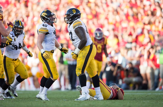 Iowa Hawkeyes defensive lineman Jaleel Johnson (67) celebrates with linebacker Parker Hesse (40) after sacking Iowa State Cyclones quarterback Sam B. Richardson (12) during the second half of their game in the Iowa Corn Cy-Hawk Series Saturday, Sept. 12, 2015 at the Jack Trice Stadium in Ames. (Brian Ray/hawkeyesports.com)