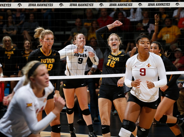 Hawkeyes Jess Janota, Annika Olsen, Lauren Brobst, and Loxley Keala celebrate a point during a 3-1 victory against Iowa State on Sept. 11 in Carver-Hawkeye Arena. (Darren Miller/hawkeyesports.com)